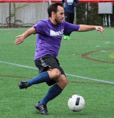 BSSC Coed Soccer League in Boston MA Players Fight for Ball Posession