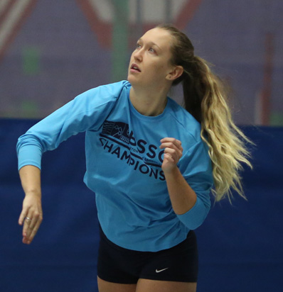 BSSC Indoor Volleyball Player in Blue Serves Ball inside gym