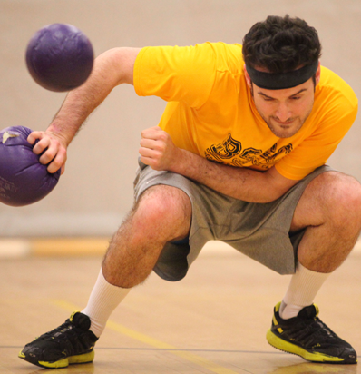 BSSC Coed Dodgeball League in Boston Player Ducks Ball and Tags Out