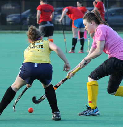 BSSC Field Hockey Women's Field Hockey League in Boston, MA Two Female Players in Pink and Yellow Run with Ball
