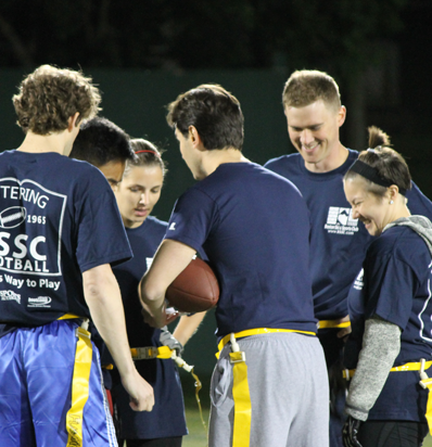 BSSC Football Coed Adult Football in Greater Boston Coed Teammates in Navy Blue Tee Shirts Gather for a Team Huddle