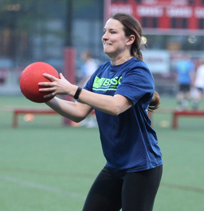 BSSC Kickball League in Boston, MA Female Player Catches Large Red Rubber Kickball