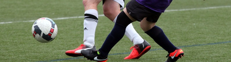 BSSC Men's and Coed Soccer Cleats and Ball on Soccer Field in Boston Massachusetts
