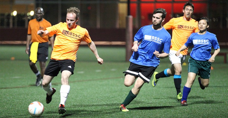 BSSC Adult Men's Outdoor Soccer Players on Turf Field Beneath Lights