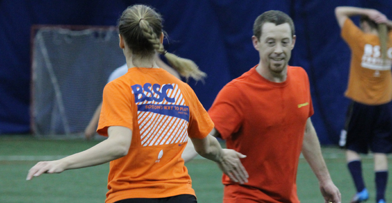 BSSC Indoor Soccer League in Boston Coed Teammates in Orange Soccer Jersey Tee Shirts Low Five