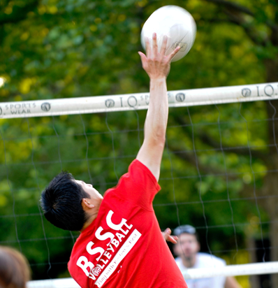 BSSC Volleyball Outdoor Volleyball League Male Volleyball Player From Behind in red Tee Shirt Jersey Jumps to Spike Volleyball over Net at Opponents