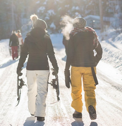 BSSC Women Walking on Snowy Road in Mountains Yellow snow pants and white snow pants Cold Breath