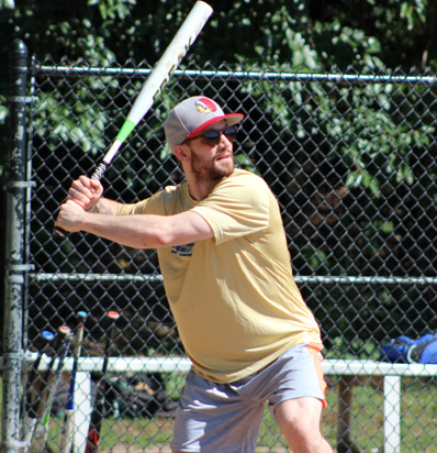 BSSC Outdoor Softball Player in sunglasses takes his stance to bat