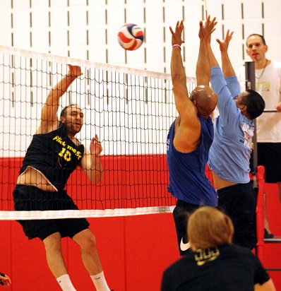 BSSC Indoor Volleyball Male Players Jump in unison to block opponents spike